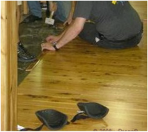 Picture - Inspecting Australian Cypress flooring..